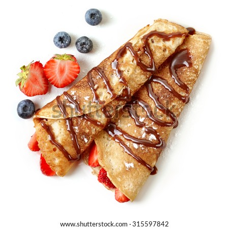 Crepes with strawberries and chocolate sauce isolated on white background - stock photo