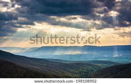 Crepuscular rays over the Shenandoah Valley, seen from Skyline Drive in Shenandoah National Park, Virginia. - stock photo