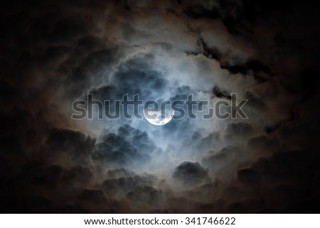 Crescent moon at the night sky with cloud - stock photo