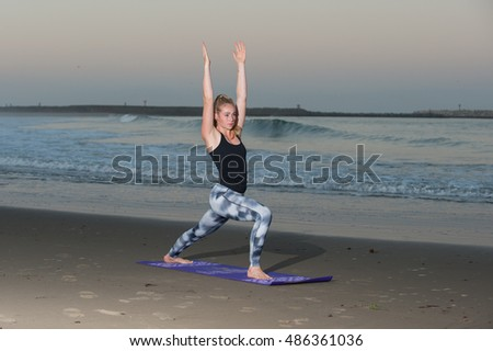 Crescent Moon Yoga pose in pattern tights along coastline.