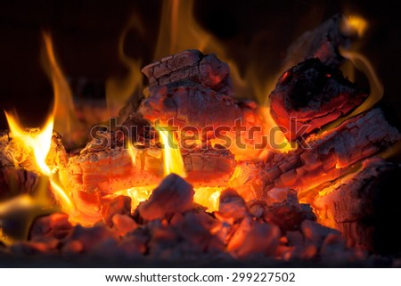 crest of flame on burning wood in fireplace,fire in the oven - stock photo