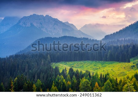 Cresta di Enghe mountain range at foggy summer morning. Dolomites mountains, Italy, Europe. - stock photo