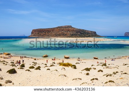 Crete, Greece - 24 May, 2016: Unidentified people sunbathing and strolling along the beach in Balos Lagoon on Crete, Greece