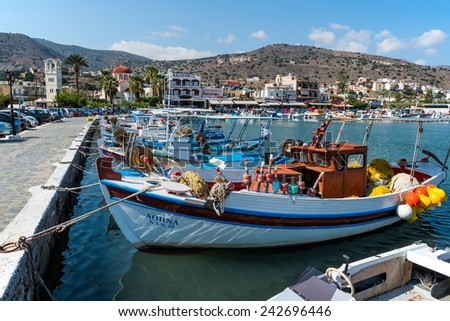 CRETE, GREECE - OCTOBER 10: picturesque Elounda Harbour with fishing boats on October 10, 2014 in Crete, Greece. - stock photo