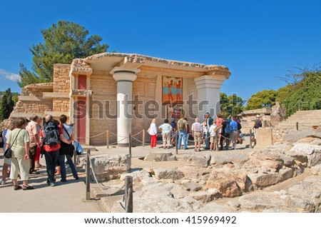 CRETE, GREECE - OCTOBER 21, 2008: Unidentified tourists near South Propylaeon at the Knossos palace on the Crete island in Greece. Knossos is the largest Bronze Age archaeological site on Crete