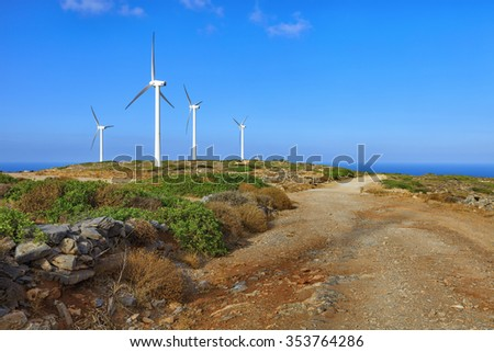 Crete island, Greece: windsmills in mountains over the sea