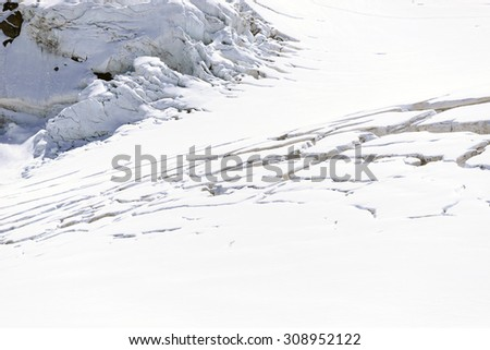 Crevasses on the glacier: danger for climbers - stock photo