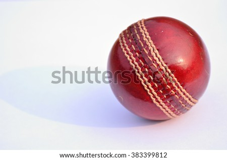 Cricket ball in isolated on white. Classic red leather ball.