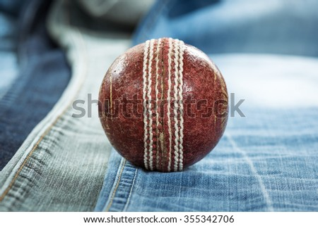 Cricket Ball on Jeans - stock photo