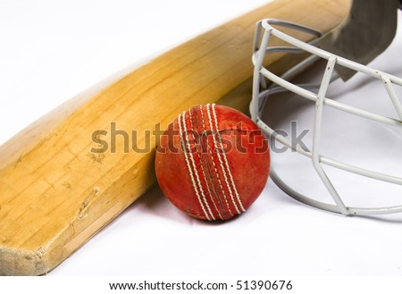 Cricket bat with a red ball seam facing forward with protective helmit on white - stock photo