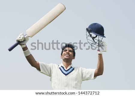 Cricket batsman celebrating his success