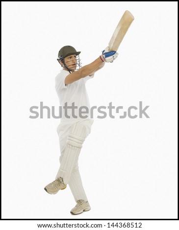Cricket batsman playing a hook shot - stock photo