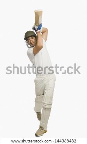 Cricket batsman playing a straight drive - stock photo