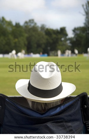 Cricket fan in sun hat - stock photo