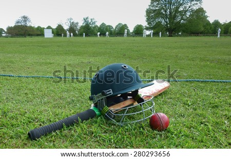 Cricket match on English village green - stock photo