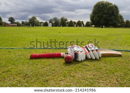 Cricket on the English village green. - stock photo