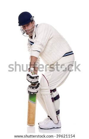 Cricketer getting ready to face the ball, studio shot on white background. - stock photo