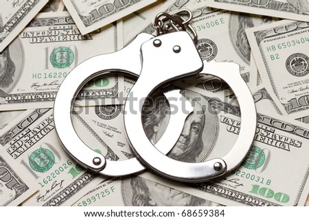 Crime law handcuffs arrests paper dollars currency - stock photo