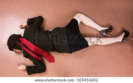 Crime scene imitation. Killed business woman lying on the floor - stock photo