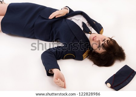 Crime scene imitation. Woman officer lying on a floor - stock photo