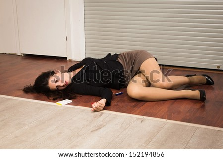 Crime scene in a office with lifeless businesswoman lying on the floor