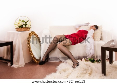Crime scene in a retro style. Killed woman lying on the sofa - stock photo