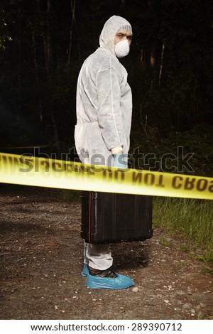 Crime scene investigation - criminologist on crime scene - stock photo