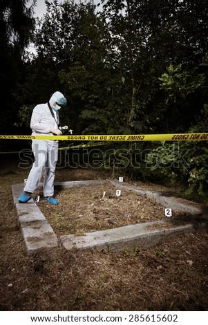 Crime scene investigation - criminologist on place of crime - stock photo