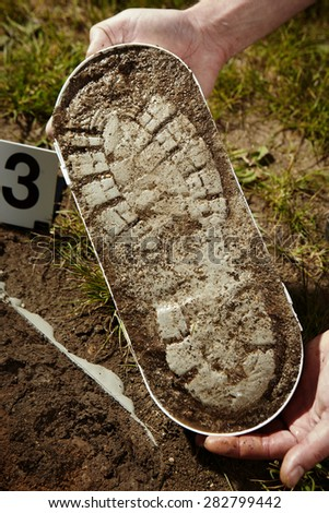 Crime scene investigation - evidence of footprint - stock photo