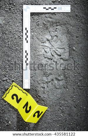 Crime scene investigation - footprint of criminal - stock photo