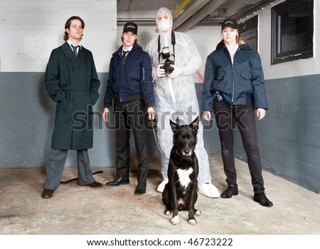 Crime scene investigation team, with an inspector, two uniformed police with a police dog and a forensic detective