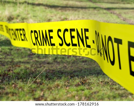 Crime scene tape being used to protect a criminal investigation - stock photo