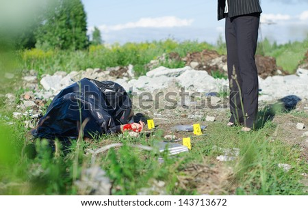 Crime scene with corpse and evidence - stock photo