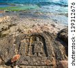 CRIMEA - MAY 06: New tourist attraction - Rock carvings on the seashore (icon of the saint with his staff) created by an unknown contemporary author  near Sevastopol (Crimea), Ukraine, May 6, 2013. - stock photo