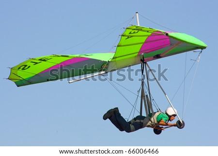 CRIMEA, UKRAINE - SEPTEMBER 9: Competitor  of the Grininko hang gliding competitions taking part on the Klementieva mountain on September 9, 2010 in Crimea, Ukraine - stock photo