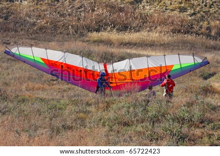CRIMEA, UKRAINE - SEPTEMBER 9: Competitor  of the hang gliding competitions takes part on the Klementieva mountain on September 9, 2010 in Crimea, Ukraine - stock photo
