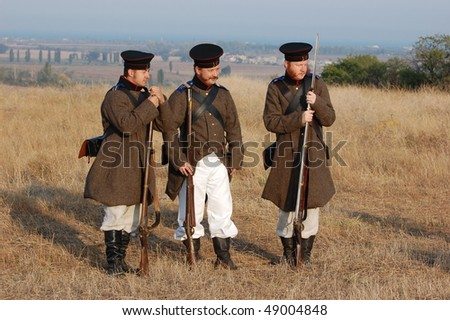 CRIMEA, UKRAINE - SEPTEMBER 26: Members of military history club ALMA wear Russian historical uniform during historical reenactment of Crimean War September 26, 2009 in Crimea, Ukraine