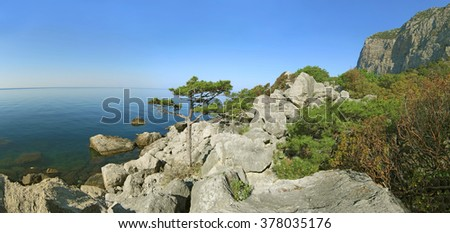 Crimean landscape. Panoramic view of the rocky shore of the Black Sea with pine Stankevich, forest and mountains. Cape Aya. - stock photo