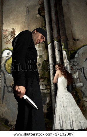 Criminal and the victim adhered to a pipe in the thrown building - stock photo