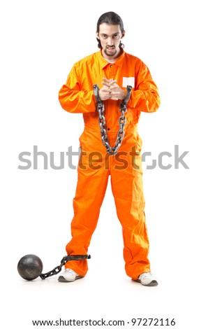 Criminal in orange robe in prison - stock photo