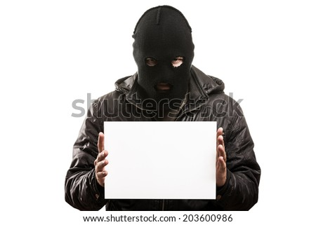 Criminal man in balaclava or mask covering face hand holding blank card white isolated - stock photo