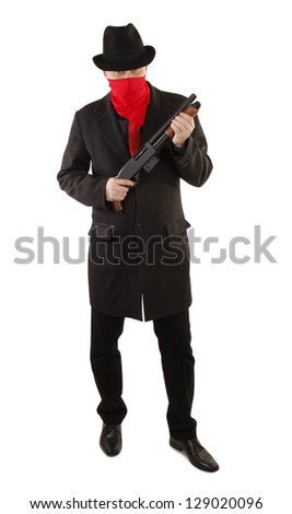 Criminal masked with red scarf with shotgun