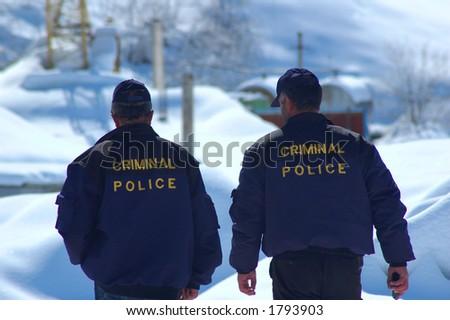 Criminal Police patrolling in winter - stock photo