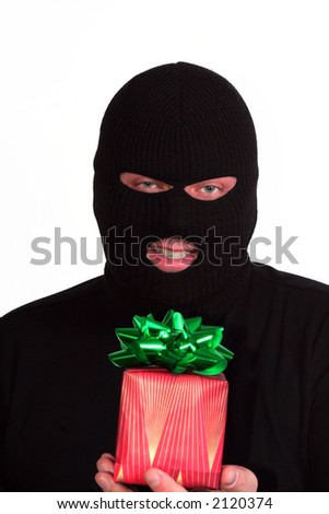 Criminal series 9 - masked bandit holding a wrapped Christmas gift - stock photo