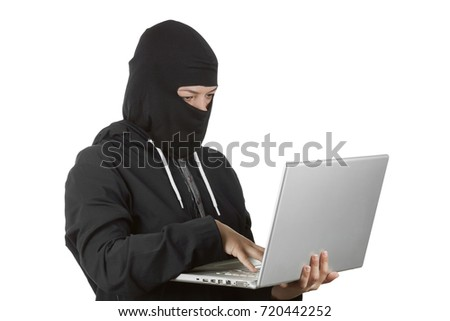 Criminal Woman Hacker Wearing Hood On in Black Clothes and Balaclava Using a Laptop on a white background