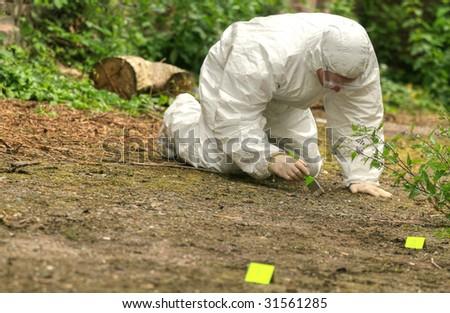 criminologist investigates a crime scene - stock photo