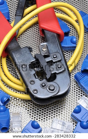 Crimping tool with network cable and connectors - stock photo
