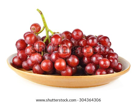 Crimson grapes on a plate. - stock photo