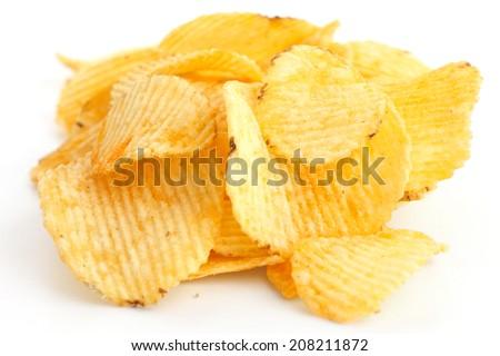 Crinkle cut crisps on white background. - stock photo