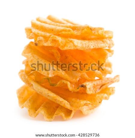Crinkle cut potato chips isolated on white background. Pile of tasty potato chips. - stock photo